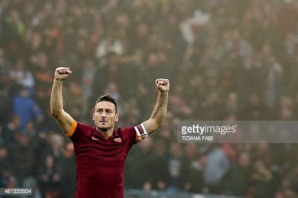Roma's forward Francesco Totti celebrates after scoring during the Italian Serie A football match AS Roma vs Lazio on January 11 2015 at the Olympic...
