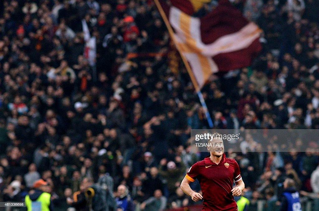 Roma's forward Francesco Totti celebrates after scoring during the Italian Serie A football match AS Roma vs Lazio on January 11, 2015 in Rome.