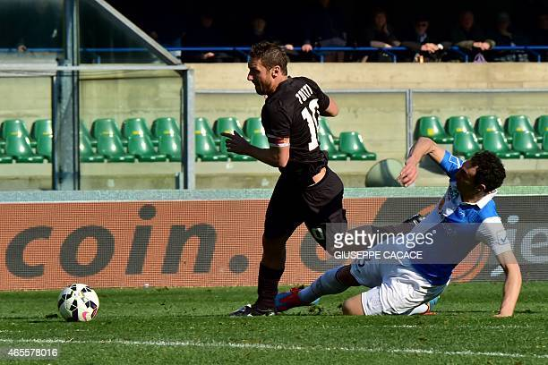 Roma's forward Francesco Totti is tackled by Chievo's defender Dario Dainelli during the Italian Serie A football match Chievo Verona vs AS Roma at...
