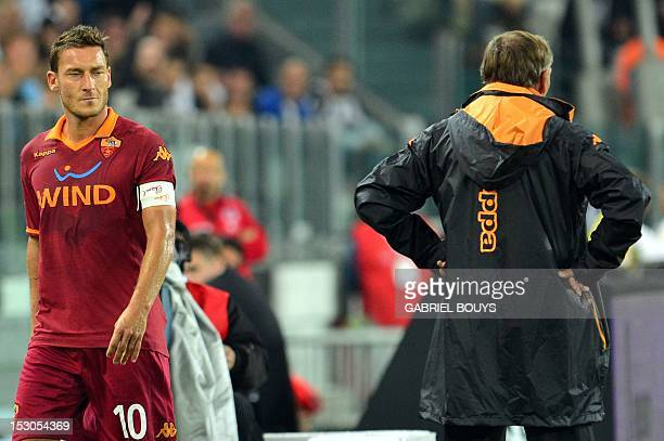 AS Roma's forward Francesco Totti looks at his coach Zdenek Zeman as he leaves the pitch during an Italian Serie A football match between Juventus...