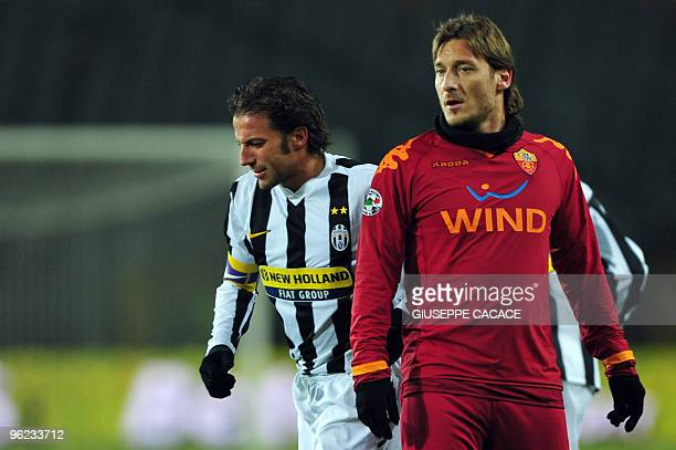 AS Roma's forward Francesco Totti looks on flanked by Juventus forward Alessandro Del Piero during the Serie A football match Juventus vs AS Roma at...