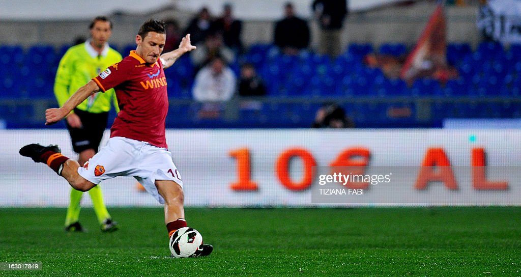 AS Roma's forward Francesco Totti scores a penalty during the Italian Serie A football match AS Romsa vs Genoa at Olympic Stadium on March 3, 2013 in Rome.