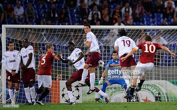 AS Roma's forward Francesco Totti shoots a free kick against Cluj during their UEFA Champions League Group E football match in Rome's Olympic Stadium...