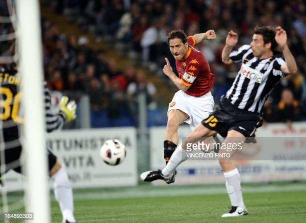 AS Roma's forward Francesco Totti shoots the ball over Juventus' defender Andrea Barzagli during their Serie A football match at the Olympic stadium...