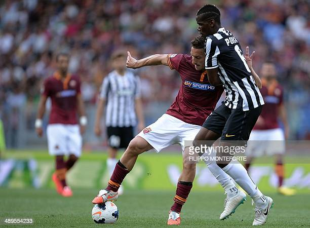 AS Roma's forward Francesco Totti vies with Juventus' French midfielder Paul Labile Pogba during the Italian Serie A football match AS Roma vs...