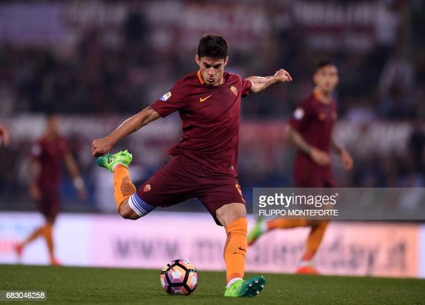 AS Roma's forward from Argentina Diego Perotti shoots the ball during the Italian Serie A football match Roma vs Juventus on May 14 2017 at Rome's...