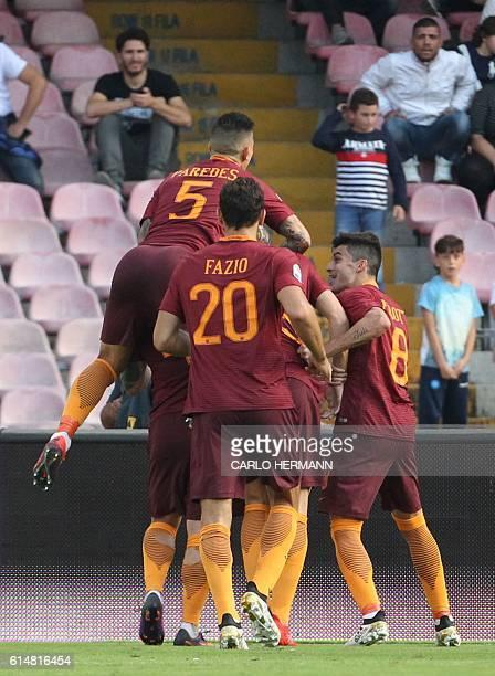 Roma's forward from Bosnia and Herzegovina Edin Dzeko celebrate with teammates after scoring during the Italian Serie A football match SSC Napoli vs...