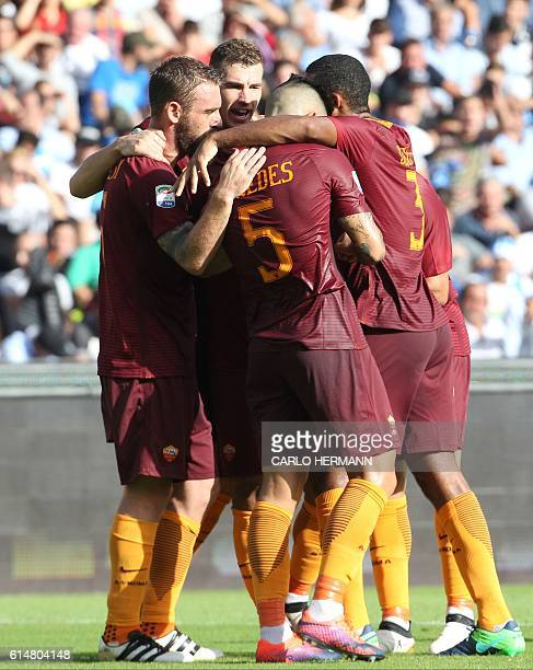 Roma's forward from Bosnia and Herzegovina Edin Dzeko celebrates with teammates after scoring during the Italian Serie A football match SSC Napoli vs...