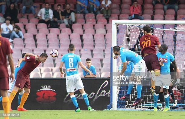 Roma's forward from Bosnia and Herzegovina Edin Dzeko scores during the Italian Serie A football match SSC Napoli vs AS Roma on October 15 2016 at...