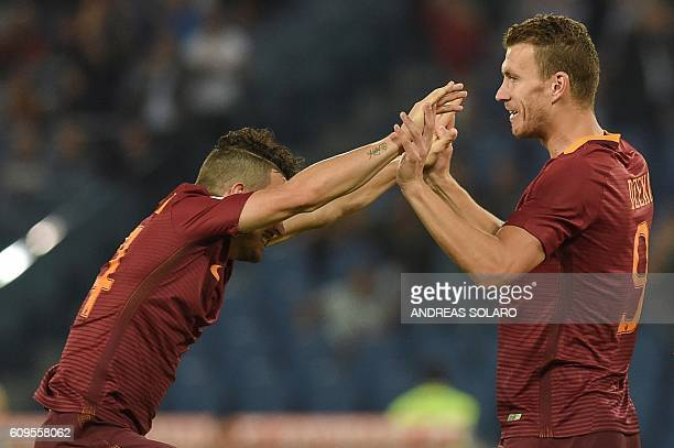AS Roma's forward From Bosnia Edin Dzeko celebrates after scoring a goal during the Italian Serie A football match AS Roma vs Crotone on September 21...