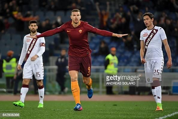 AS Roma's forward From Bosnia Edin Dzeko celebrates after scoring during the Italian Serie A football match AS Roma versus Torino on February 19 2017...