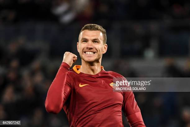 AS Roma's forward From Bosnia Edin Dzeko celebrates after scoring during the Italian Serie A football match AS Roma versus Torino on February 19 2017...