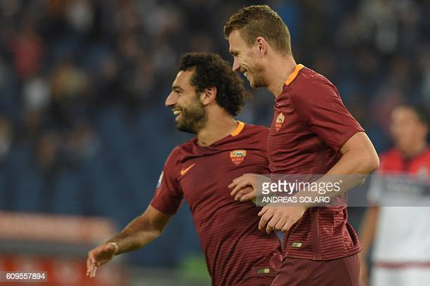 AS Roma's forward From Bosnia Edin Dzeko celebrates with AS Roma's midfielder from Egypt Mohamed Salah after scoring a goal during the Italian Serie...