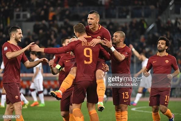 AS Roma's forward From Bosnia Edin Dzeko celebrates with his teammates after scoring during the Italian Serie A football match AS Roma versus Torino...