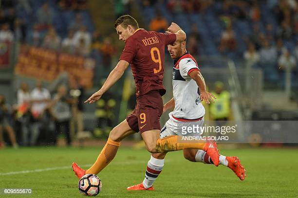 AS Roma's forward From Bosnia Edin Dzeko fights for the ball with Crotone's defender from Italy Mario Sampirisi during the Italian Serie A football...