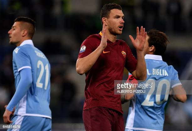AS Roma's forward From Bosnia Edin Dzeko reacts during the Italian TIM Cup 1st leg semifinal football match on March 1 2017 at the Olympic stadium in...