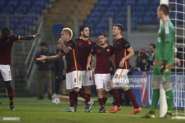 Roma's forward from BosniaHerzegovina Edin Dzeko celebrates with teammates Roma's midfielder from Mali Seydou Keita Roma's midfielder from Belgium...
