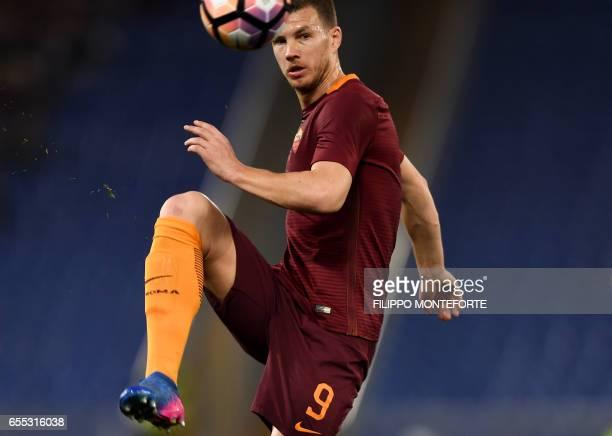 TOPSHOT Roma's forward from BosniaHerzegovina Edin Dzeko controls the ball during the italian Serie A football match Roma vs Sassuolo at the Olympic...