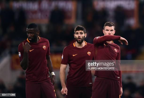 Roma's forward from BosniaHerzegovina Edin Dzeko defender from Argentina Federico Fazio and defender from Grermany Antonio Rudiger react during the...