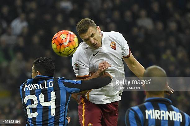 Roma's forward from BosniaHerzegovina Edin Dzeko fights for the ball with Inter Milan's Colombian defender Jeison Murillo during the Italian Serie A...