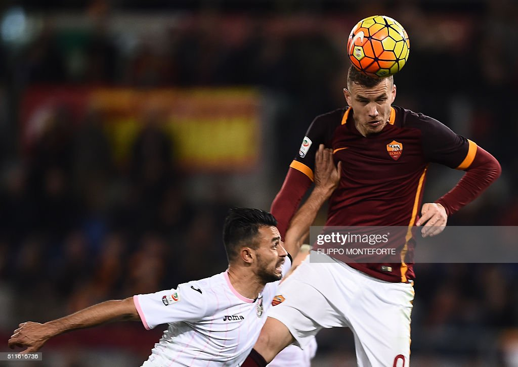 Roma's forward from BosniaHerzegovina Edin Dzeko heads the ball to score during the italian Serie A football match Roma vs Palermo at the Olympic...