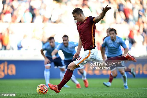 Roma's forward from BosniaHerzegovina Edin Dzeko kicks a penalty during the Italian Serie A football match AS Roma vs SS Lazio at the Olympic Stadium...