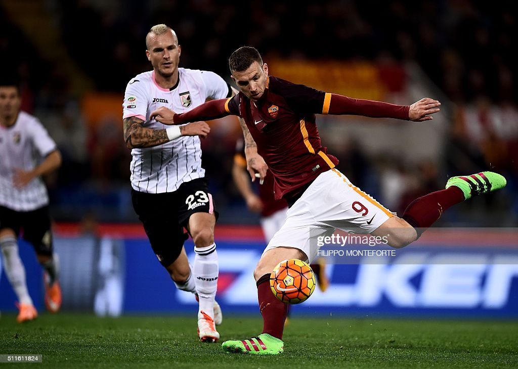 Roma's forward from BosniaHerzegovina Edin Dzeko kicks to score during the italian Serie A football match Roma vs Palermo at the Olympic Stadium in...