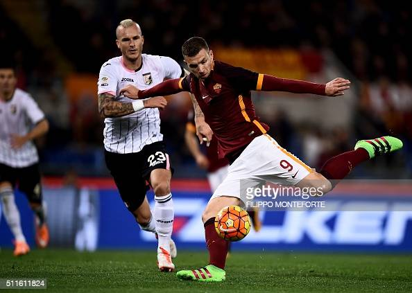 Roma's forward from BosniaHerzegovina Edin Dzeko kicks to score during the italian Serie A football match Roma vs Palermo at the Olympic Stadium in...