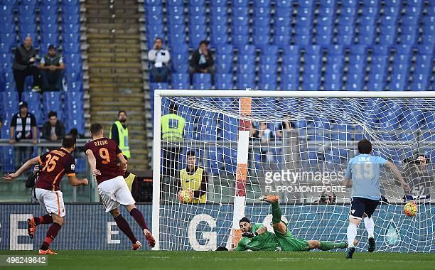 Roma's forward from BosniaHerzegovina Edin Dzeko scores a penalty against Lazio's goalkeeper from Italy Federico Marchetti during the Italian Serie A...