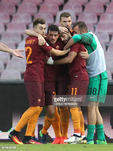 Roma's forward from Egypt Mohamed Salah celebrates with teammates after scoring during the Italian Serie A football match SSC Napoli vs AS Roma on...