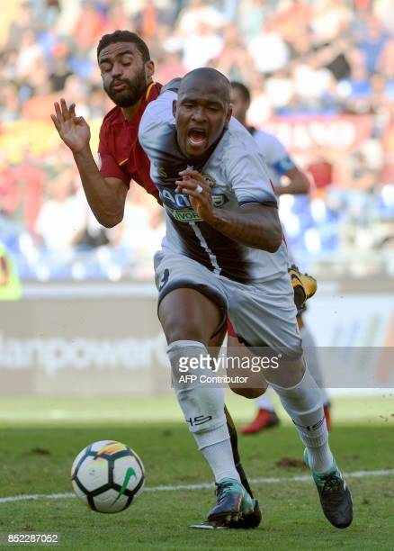 AS Roma's forward from France Gregoire Defrel vies with Udinese defender from Brazil Caetano de Souza Santos Samir during the Italian Serie A...
