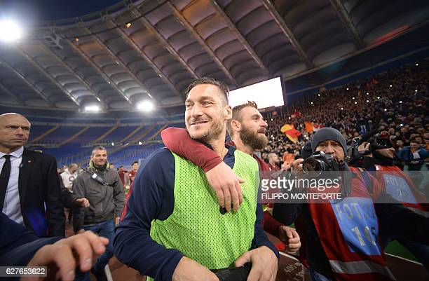 Roma's forward from Italy Francesco Totti and Roma's midfielder from Italy Daniele De Rossi celebrate after winning the Italian Serie A football...