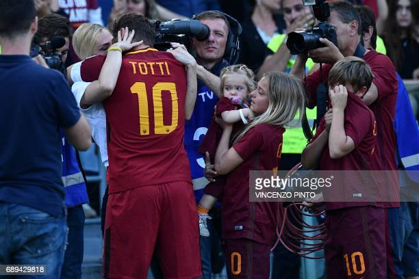 Roma's forward from Italy Francesco Totti embraces his wife Ilary Blasi next to his children Cristian Totti Isabel Totti and Chanel Totti during a...
