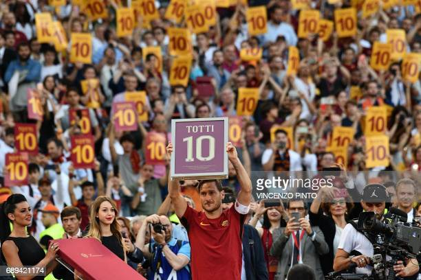 TOPSHOT Roma's forward from Italy Francesco Totti holds a framed Number 10 during a ceremony to celebrate his last match with AS Roma after the...