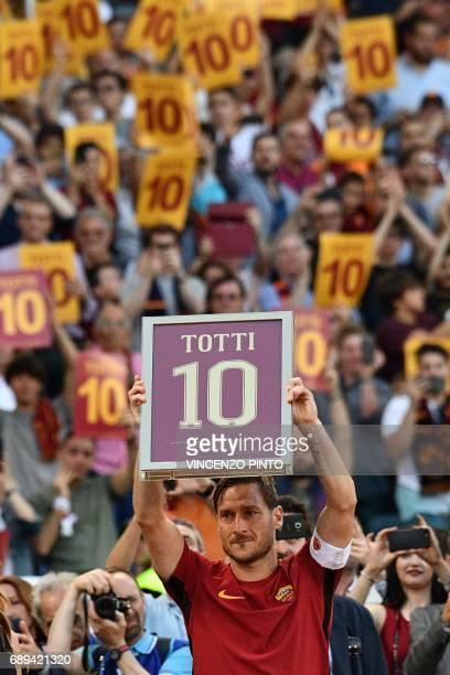 Roma's forward from Italy Francesco Totti holds a framed Number 10 during a ceremony to celebrate his last match with AS Roma after the Italian Serie...