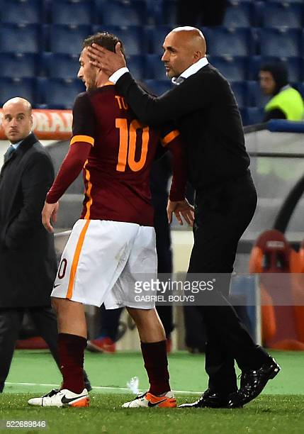 Roma's forward from Italy Francesco Totti is congratulated by Roma's coach from Italy Luciano Spalletti during the Italian Serie A football match...