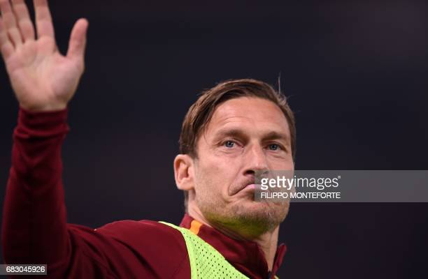 Roma's forward from Italy Francesco Totti waves to his fans during the Italian Serie A football match Roma vs Juventus on May 14 2017 at Rome's...