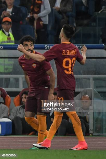 AS Roma's forward from Italy Stephan El Shaarawy celebrates with teammate Roma's midfielder from Egypt Mohamed Salah during the Italian Serie A...