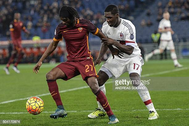 Roma's forward from Ivory Coast Gervinho fights for the ball against AC Milan's defender from Colombia Cristian Zapata during the Italian Serie A...