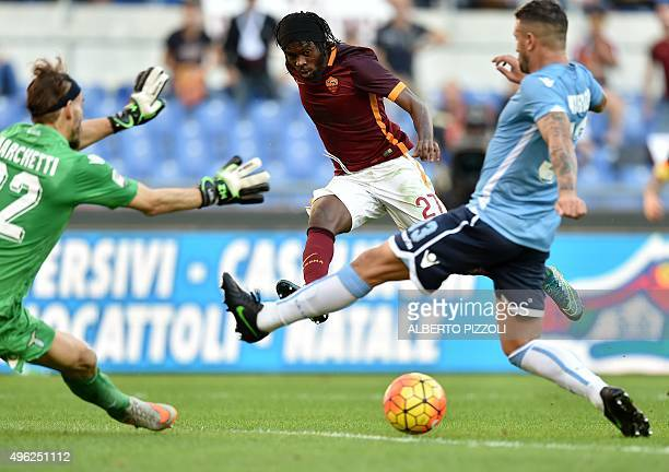 Roma's forward from Ivory Coast Gervinho fights for the ball with Lazio's goalkeeper from Italy Federico Marchetti and Lazio's midfielder from Italy...