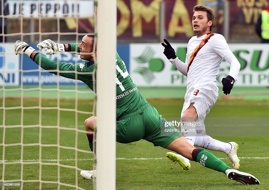 Roma's forward from Serbia Adem Ljajic scores against Cagliari's goalkeeper Zeljko Brkic during the Italian Serie A football match between Cagliari...