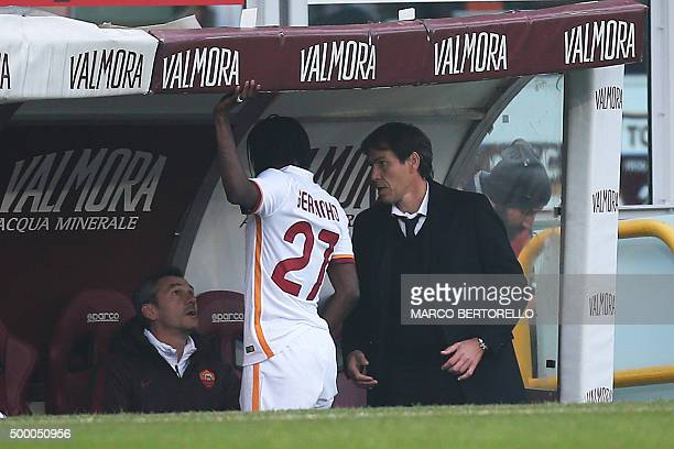 Roma's forward Gervinho from Ivory Coast chats with Roma's French coach Rudi Garcia and assistant coach Claude Fichaux during the Italian Serie A...