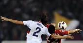 AS Roma's forward Marco Borriello fights for the ball with Genoa's defender Moreno Jose Chico Flores during their Serie A football match against...