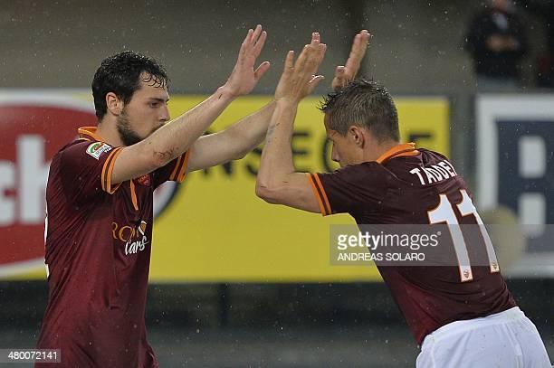 AS Roma's forward Mattia Destro celebrates with teammate AS Roma's Brazilian midfielder Taddei after scoring after scoring during the Italian Serie A...