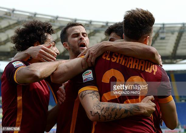 AS Roma's forward Stephan El Shaarawy celebrates with teammates after scoring during the Italian Serie A football match Lazio vs AS Roma at the...