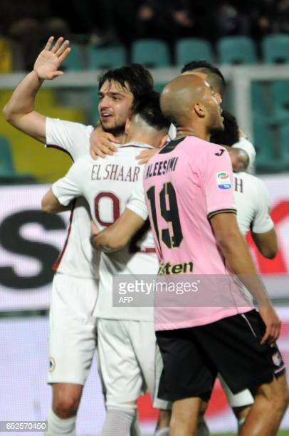 Roma's forward Stephan El Shaarawy is congratulated by teammate Roma's midfielder from France Clement Grenier after scoring during the Italian Serie...