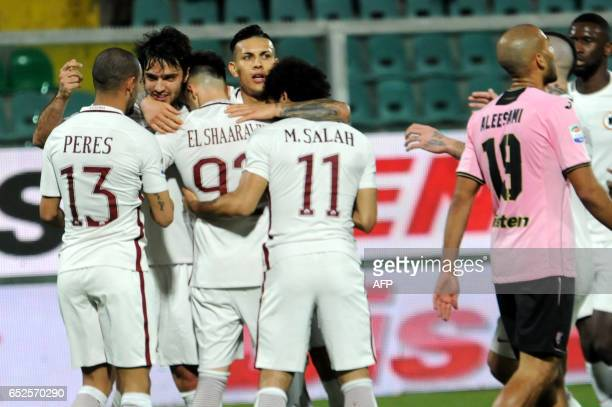 Roma's forward Stephan El Shaarawy is congratulated by teammates Roma's defender from Brazil Bruno Peres Roma's midfielder from France Clement...