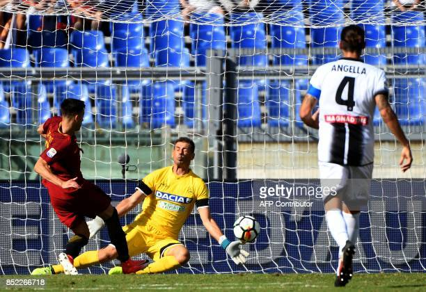 AS Roma's forward Stephan El Shaarawy scores a goal past Udinese's goalkeeper Albano Bizzarri during the Italian Serie A football match AS Roma vs...