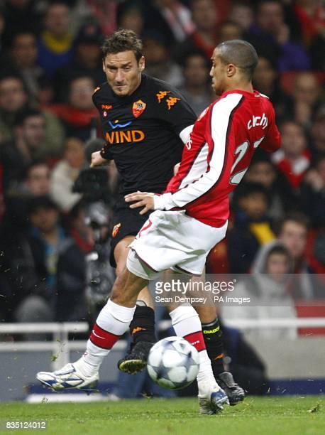 Roma's Francesco Totti and Arsenal's Gael Clichy in action