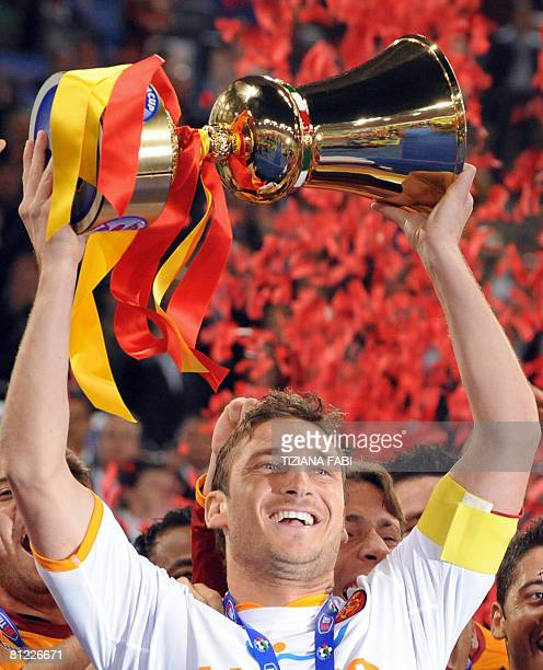 AS Roma's Francesco Totti holds up the trophy at the end of their Italian Cup soccer final match against Inter Milan at the Olympic stadium in Rome...